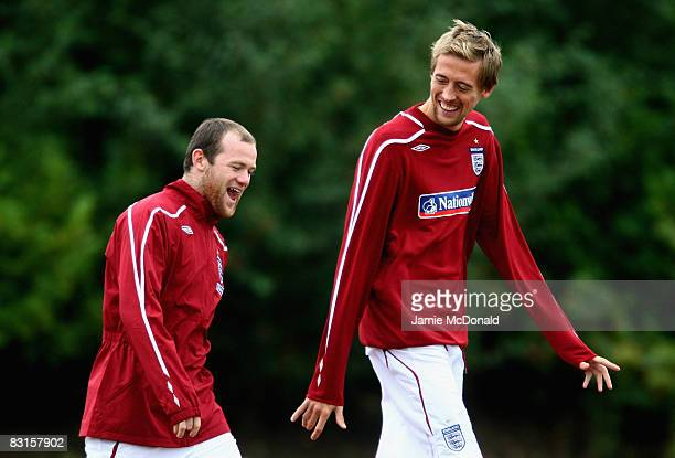 Peter Crouch and Wayne Rooney of England share a joke during an England training session at London Colney Training Ground on October 7 2008 in London...