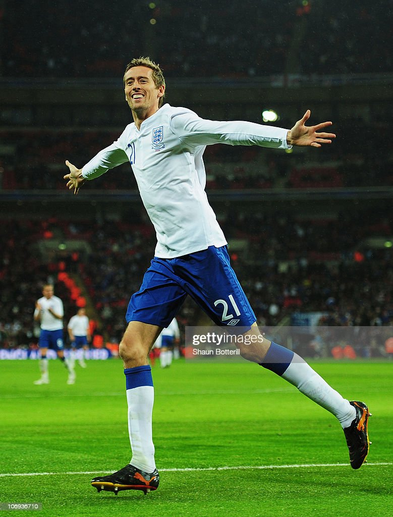 Peter Crouch of England celebrates as he scores their first goal during the international friendly match between England and France at Wembley Stadium on November 17, 2010 in London, England.