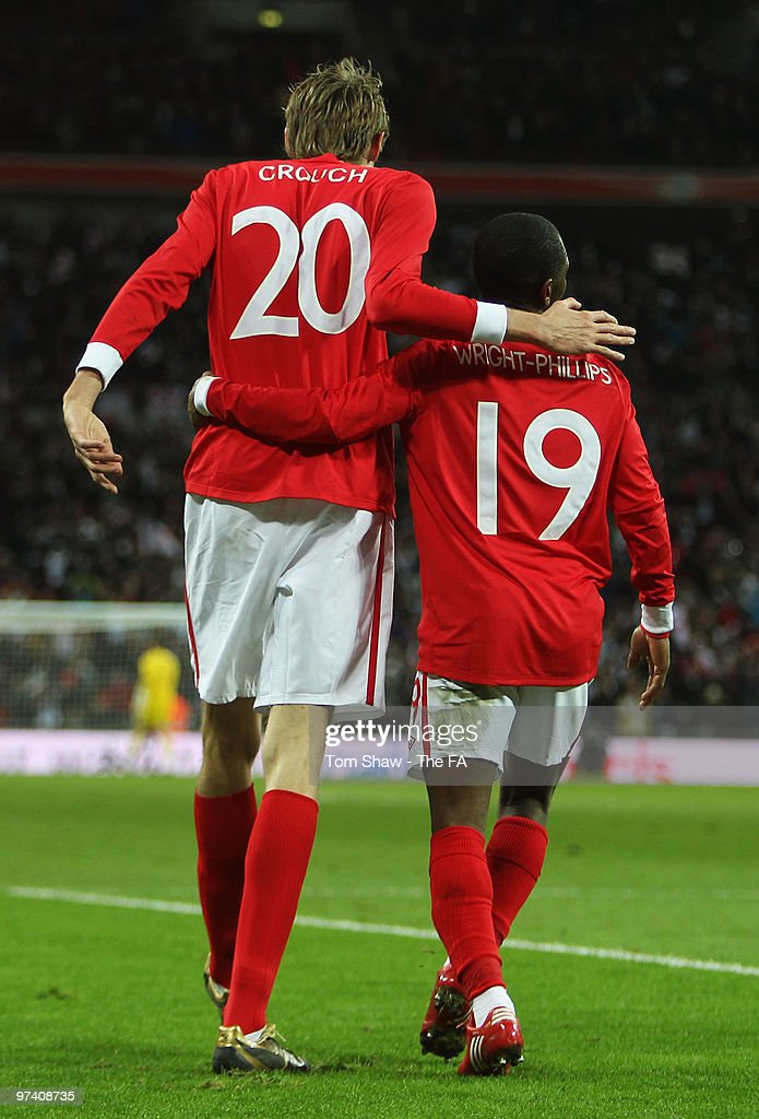 Peter Crouch of England celebrates with Shaun WrightPhillips as Shaun scores their second goal during the International Friendly match between...
