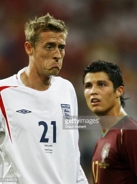 Peter Crouch of England pulls a face as Cristiano Ronaldo of Portugal looks on during the FIFA World Cup Germany 2006 Quarterfinal match between...
