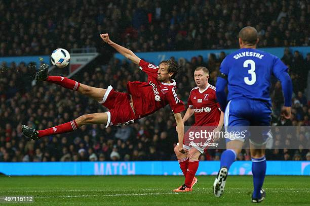 Peter Crouch of Great Britain and Ireland directs an acrobatic shot on goal during the David Beckham Match for Children in aid of UNICEF between...