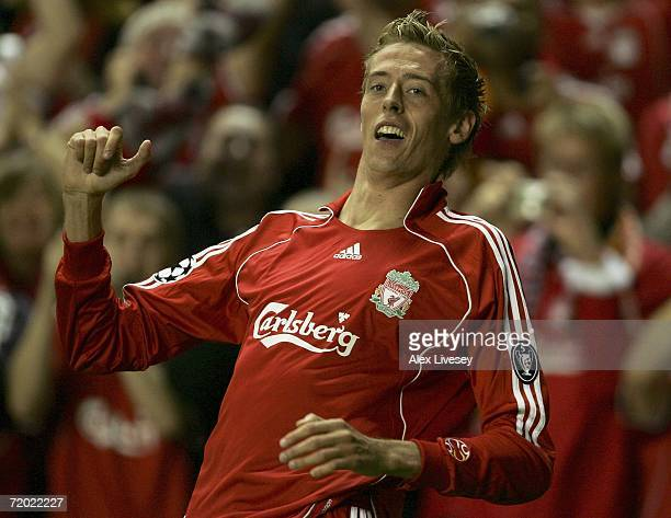 Peter Crouch of Liverpool celebrates after scoring his team's third goal during the UEFA Champions League group C match between Liverpool and...
