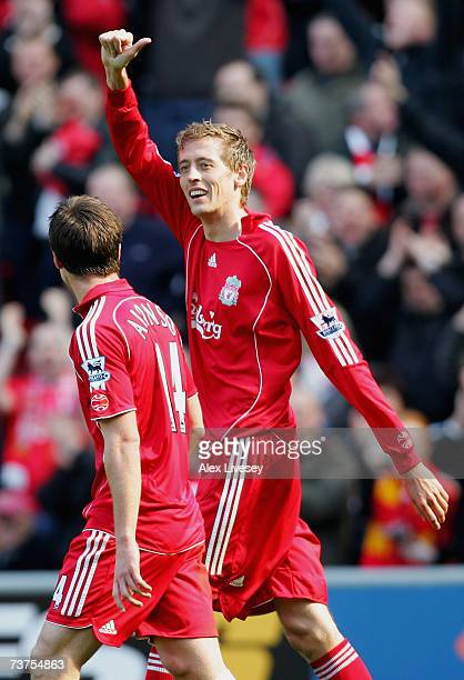 Peter Crouch of Liverpool celebrates scoring his team's fourth goal to complete his hattrick during the Barclays Premiership match between Liverpool...