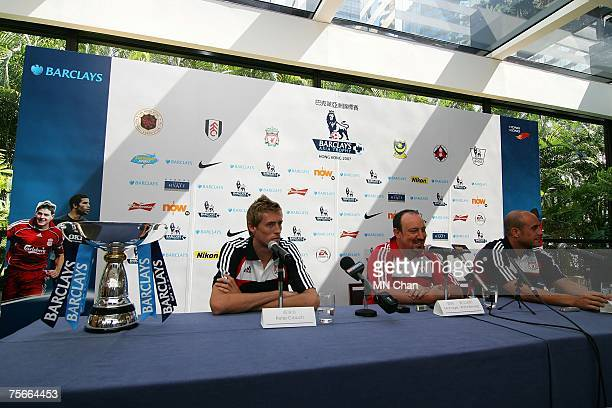 Peter Crouch of Liverpool Rafael Benitez and Pepe Reina attend the preseason Barclays Asia Trophy match press conference on July 26 2007 in Hong Kong...