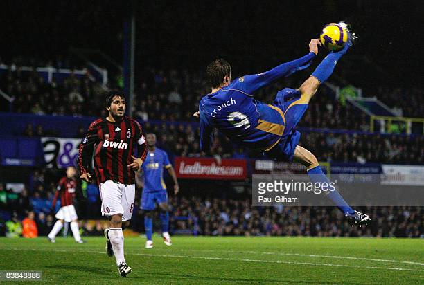 Peter Crouch of Portsmouth overhead kicks watched by Gennaro Gattuso of AC Milan during the UEFA Cup Group E match between Portsmouth and AC Milan at...