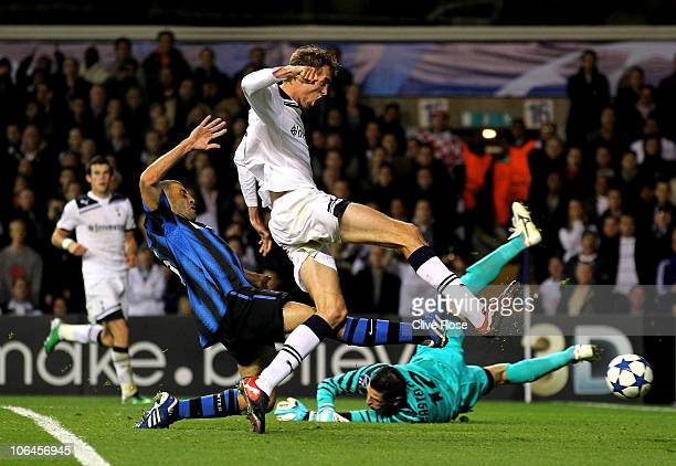 Peter Crouch of Spurs holds off the challenge from Walter Samuel of Inter Milan to score his team's second goal during the UEFA Champions League...