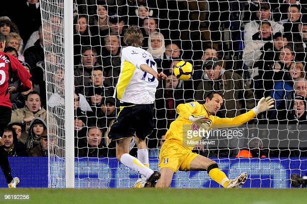 Peter Crouch of Spurs scores the opening goal past Mark Schwarzer of Fulham during the Barclays Premier League match between Tottenham Hotspur and...