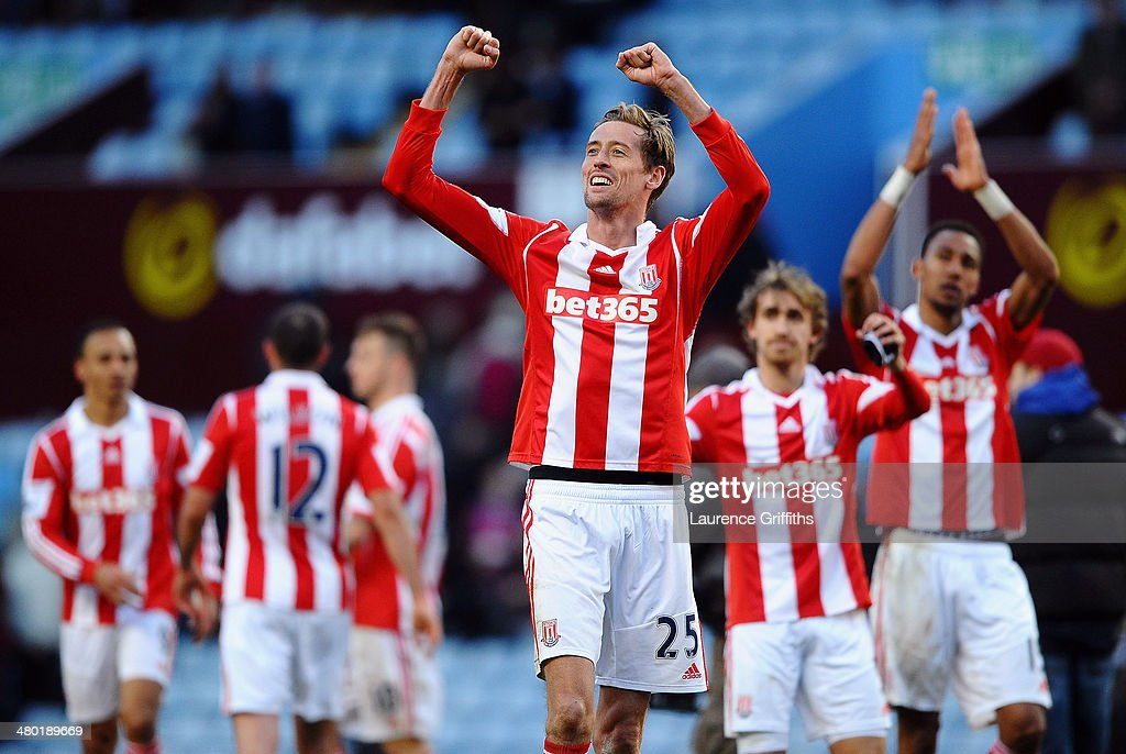 <a gi-track='captionPersonalityLinkClicked' href=/galleries/search?phrase=Peter+Crouch&family=editorial&specificpeople=210764 ng-click='$event.stopPropagation()'>Peter Crouch</a> (C) of Stoke and teammates celebrate following their team's 4-2 victory during the Barclays Premier League match between Aston Villa and Stoke City at Villa Park on March 23, 2014 in Birmingham, England.