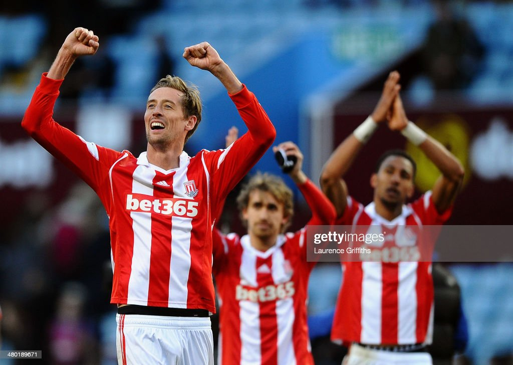 <a gi-track='captionPersonalityLinkClicked' href=/galleries/search?phrase=Peter+Crouch&family=editorial&specificpeople=210764 ng-click='$event.stopPropagation()'>Peter Crouch</a> (L) of Stoke and teammates celebrate following their team's 4-2 victory during the Barclays Premier League match between Aston Villa and Stoke City at Villa Park on March 23, 2014 in Birmingham, England.