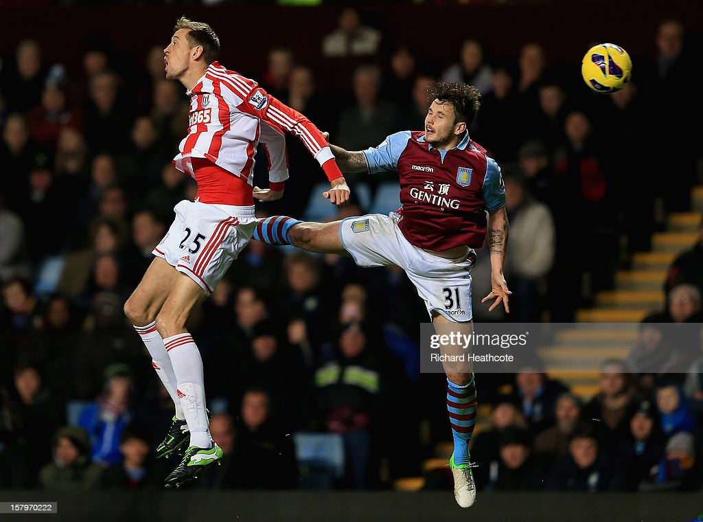 <a gi-track='captionPersonalityLinkClicked' href=/galleries/search?phrase=Peter+Crouch&family=editorial&specificpeople=210764 ng-click='$event.stopPropagation()'>Peter Crouch</a> of Stoke battles with Chris Herd of Villa during the Barclays Premier League match between Aston Villa and Stoke City at Villa Park on December 8, 2012 in Birmingham, England.