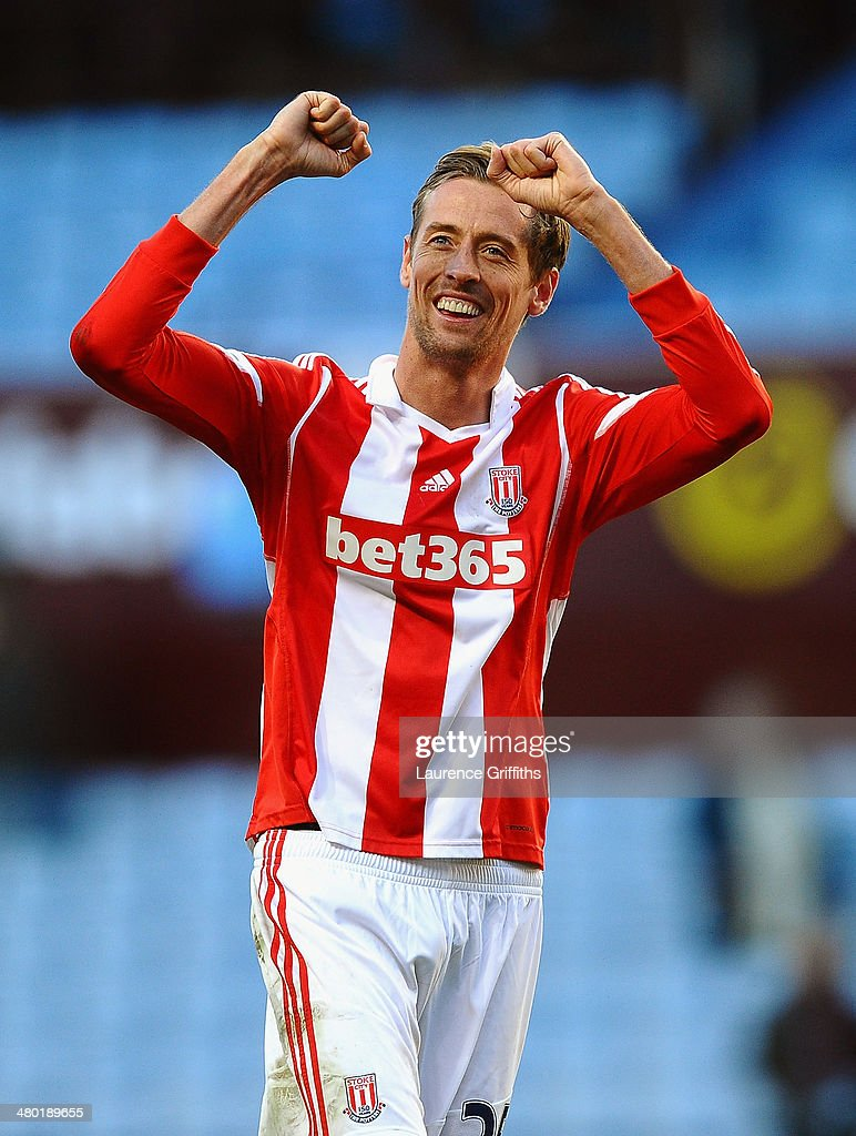 <a gi-track='captionPersonalityLinkClicked' href=/galleries/search?phrase=Peter+Crouch&family=editorial&specificpeople=210764 ng-click='$event.stopPropagation()'>Peter Crouch</a> of Stoke celebrates following his team's 4-2 victory during the Barclays Premier League match between Aston Villa and Stoke City at Villa Park on March 23, 2014 in Birmingham, England.