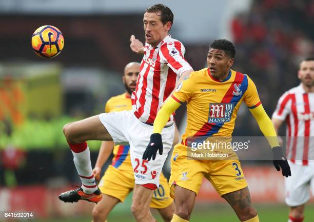 Peter Crouch of Stoke City and Patrick Van Aanholt of Crystal Palace during the Premier League match between Stoke City and Crystal Palace at Bet365...