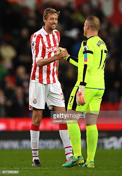 Peter Crouch of Stoke City and Paul Robinson of Burnley shake hands after the Premier League match between Stoke City and Burnley at Bet365 Stadium...