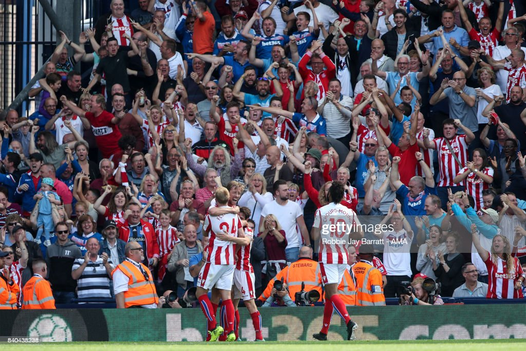 Peter Crouch of Stoke City celebrates after scoring a goal to make it 1-1 during the Premier League match between West Bromwich Albion and Stoke City at The Hawthorns on August 27, 2017 in West Bromwich, England.