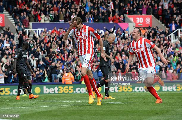 Peter Crouch of Stoke City celebrates after scoring their sixth goal during the Barclays Premier League match between Stoke City and Liverpool at...