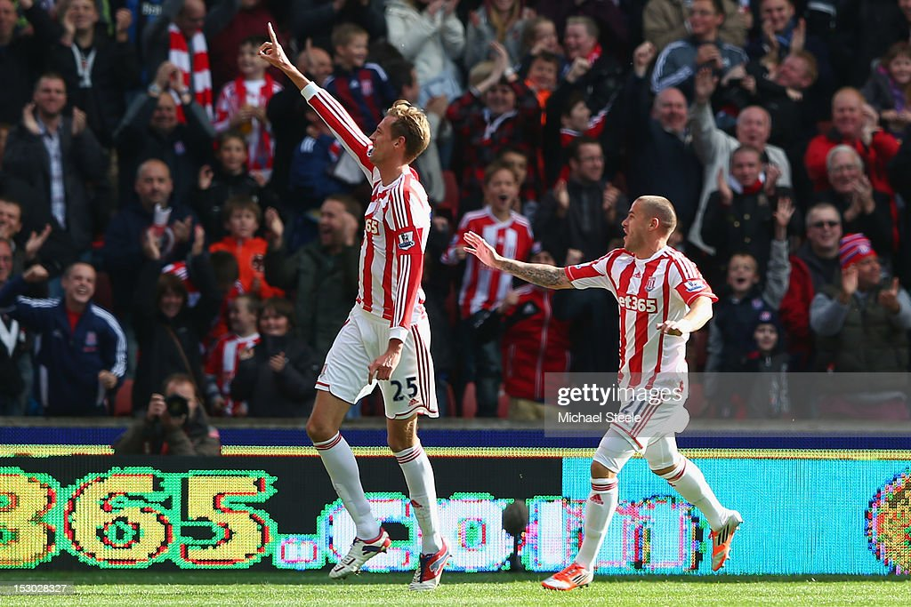 <a gi-track='captionPersonalityLinkClicked' href=/galleries/search?phrase=Peter+Crouch&family=editorial&specificpeople=210764 ng-click='$event.stopPropagation()'>Peter Crouch</a> (L) of Stoke City celebrates scoring his second goal with <a gi-track='captionPersonalityLinkClicked' href=/galleries/search?phrase=Michael+Kightly&family=editorial&specificpeople=2140595 ng-click='$event.stopPropagation()'>Michael Kightly</a> (R) during the Barclays Premier League match at the Britannia Stadium on September 29, 2012 in Stoke on Trent, England.