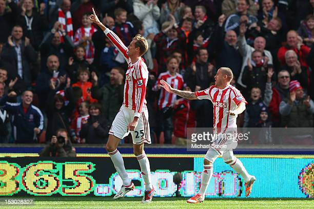 Peter Crouch of Stoke City celebrates scoring his second goal with Michael Kightly during the Barclays Premier League match at the Britannia Stadium...
