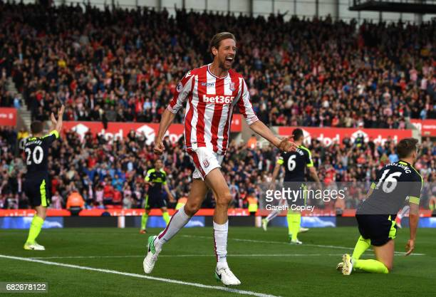 Peter Crouch of Stoke City celebrates scoring his sides first goal during the Premier League match between Stoke City and Arsenal at Bet365 Stadium...