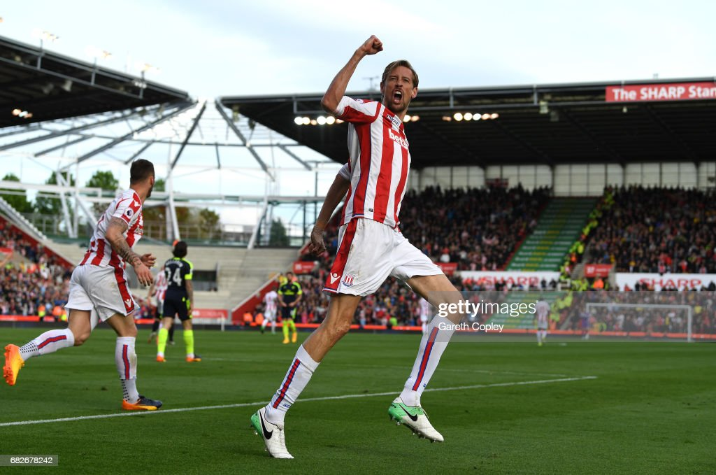Peter Crouch of Stoke City celebrates scoring his sides first goal during the Premier League match between Stoke City and Arsenal at Bet365 Stadium on May 13, 2017 in Stoke on Trent, England.