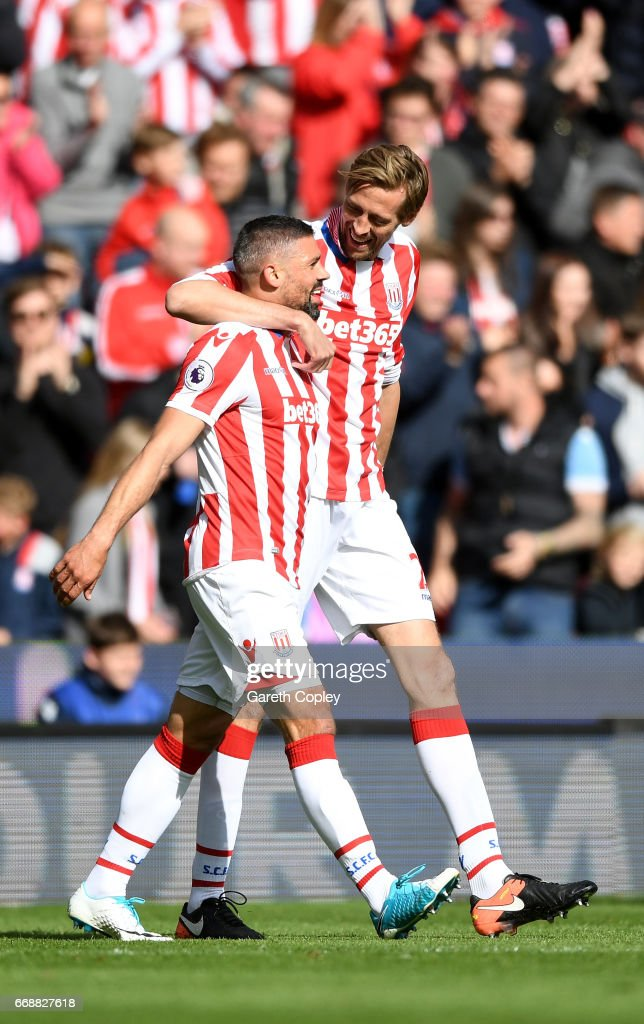Peter Crouch of Stoke City celebrates scoring his sides second goal with Jonathan Walters of Stoke City during the Premier League match between Stoke City and Hull City at Bet365 Stadium on April 15, 2017 in Stoke on Trent, England.