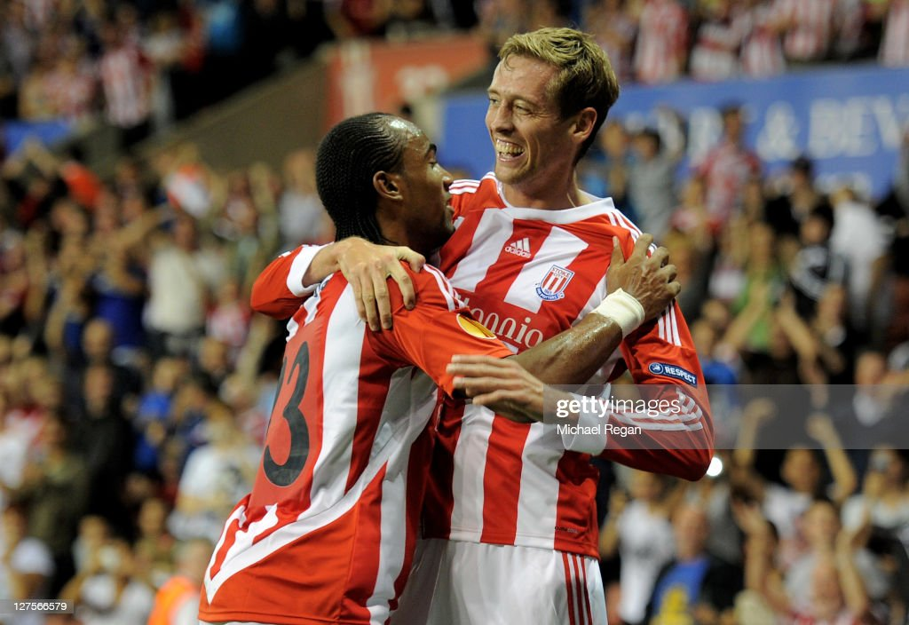<a gi-track='captionPersonalityLinkClicked' href=/galleries/search?phrase=Peter+Crouch&family=editorial&specificpeople=210764 ng-click='$event.stopPropagation()'>Peter Crouch</a> of Stoke City celebrates scoring his team's first goal with team mate <a gi-track='captionPersonalityLinkClicked' href=/galleries/search?phrase=Cameron+Jerome&family=editorial&specificpeople=815275 ng-click='$event.stopPropagation()'>Cameron Jerome</a> (L) during the UEFA Europa League Group E match between Stoke City and Besiktas JK at the Britannia Stadium on September 29, 2011 in Stoke, England.