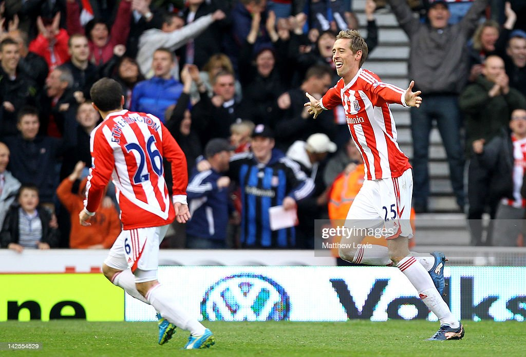 <a gi-track='captionPersonalityLinkClicked' href=/galleries/search?phrase=Peter+Crouch&family=editorial&specificpeople=210764 ng-click='$event.stopPropagation()'>Peter Crouch</a> (R) of Stoke City celebrates scoring his team's second goal during the Barclays Premier League match between Stoke City and Wolverhampton Wanderers at the Britannia Stadium on April 7, 2012 in Stoke on Trent, England.