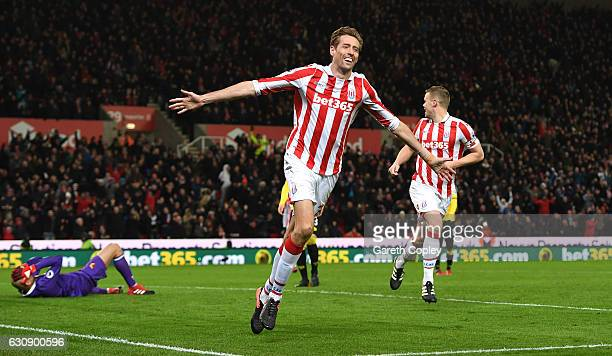 Peter Crouch of Stoke City celebrates scoring his team's second goal during the Premier League match between Stoke City and Watford at Bet365 Stadium...
