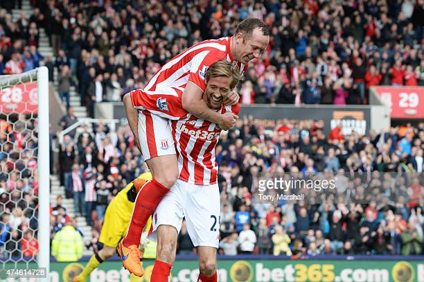 Peter Crouch of Stoke City celebrates scoring his team's sixth goal with his team mate Charlie Adam during the Barclays Premier League match between...