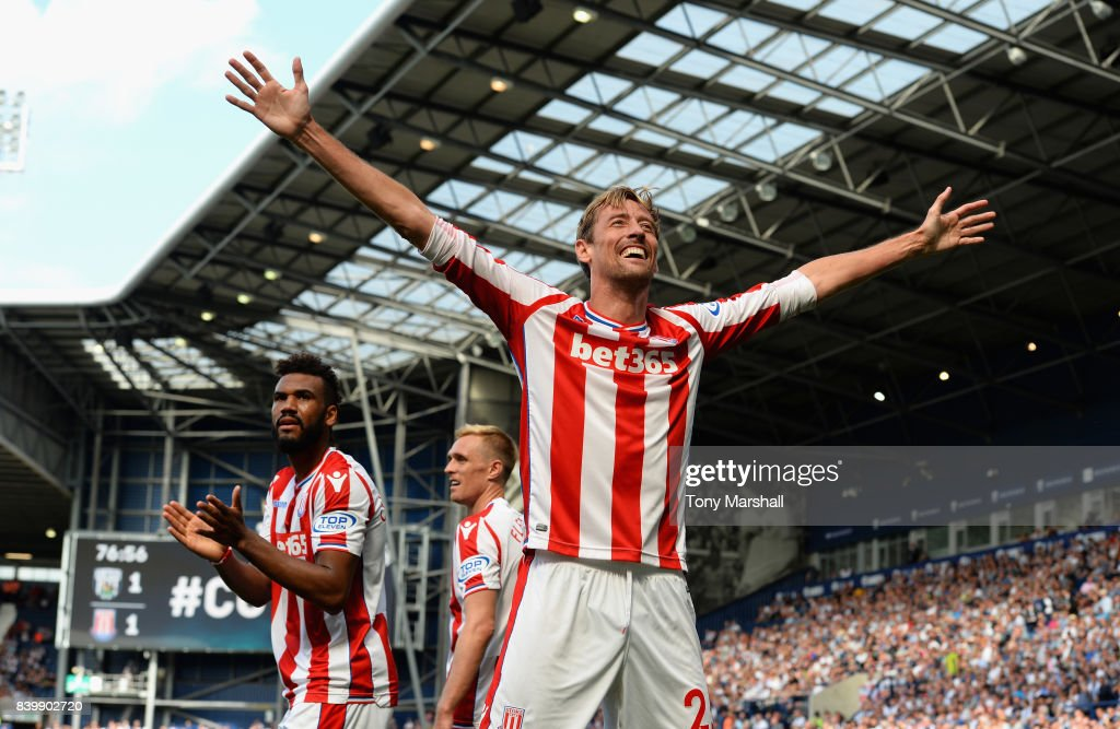 Peter Crouch of Stoke City celebrates scoring the equalising goal during the Premier League match between West Bromwich Albion and Stoke City at The Hawthorns on August 27, 2017 in West Bromwich, England.