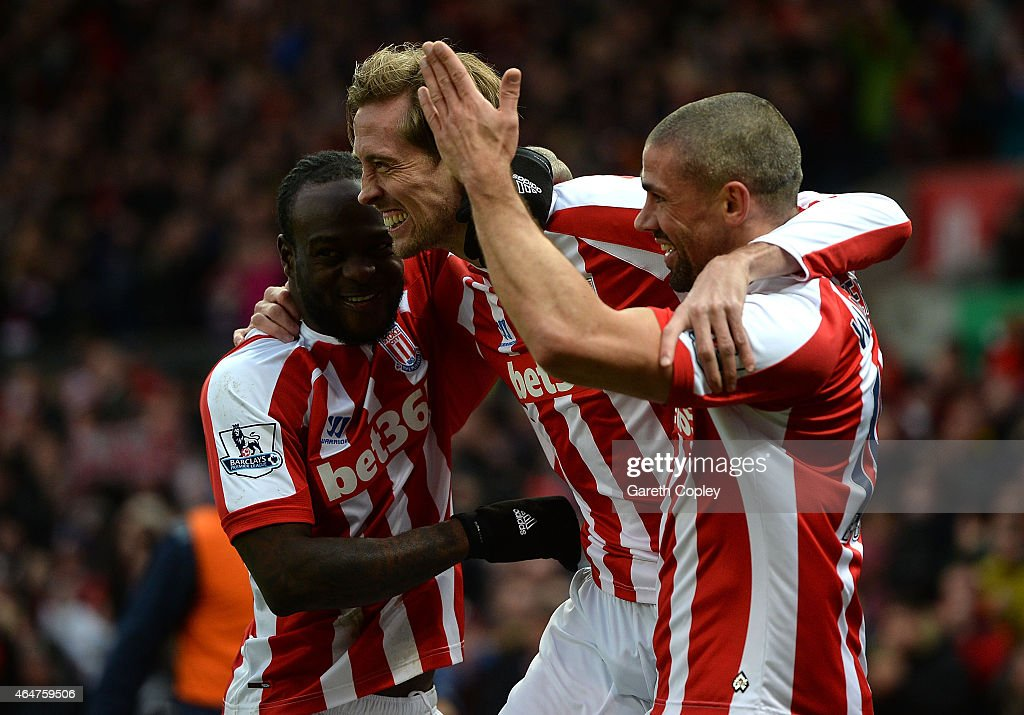 Peter Crouch of Stoke City celebrates scoring the first goal with teammates Victor Moses and Jonathan Walters during the Barclays Premier League...