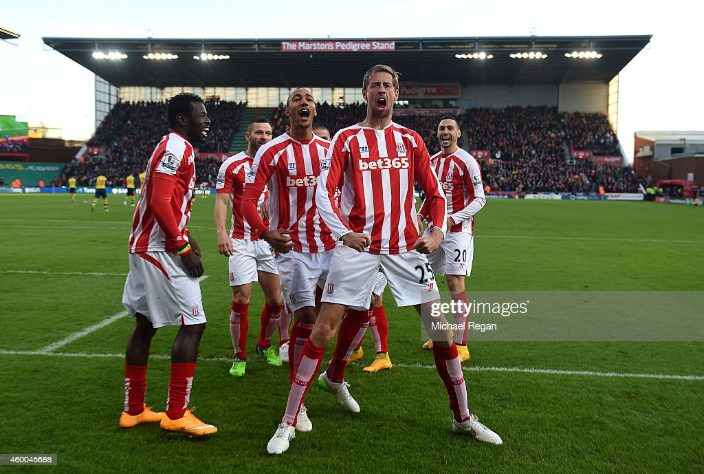 <a gi-track='captionPersonalityLinkClicked' href=/galleries/search?phrase=Peter+Crouch&family=editorial&specificpeople=210764 ng-click='$event.stopPropagation()'>Peter Crouch</a> of Stoke City celebrates scoring the opening goal with his team-mates during the Barclays Premier League match between Stoke City and Arsenal at the Britannia Stadium on December 6, 2014 in Stoke on Trent, England.
