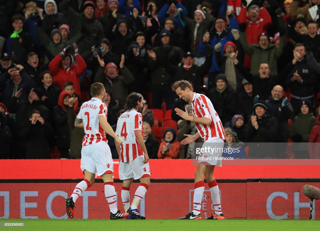 Peter Crouch (R) of Stoke City celebrates scoring the opening goal with team mates during the Premier League match between Stoke City and Everton at Bet365 Stadium on February 1, 2017 in Stoke on Trent, England.