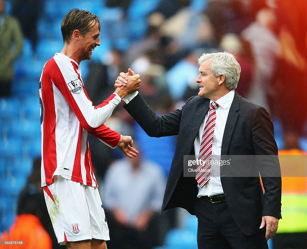 <a gi-track='captionPersonalityLinkClicked' href=/galleries/search?phrase=Peter+Crouch&family=editorial&specificpeople=210764 ng-click='$event.stopPropagation()'>Peter Crouch</a> of Stoke City celebrates victory with <a gi-track='captionPersonalityLinkClicked' href=/galleries/search?phrase=Mark+Hughes+-+Welsh+Soccer+Manager&family=editorial&specificpeople=206223 ng-click='$event.stopPropagation()'>Mark Hughes</a>, manager of Stoke City after the Barclays Premier League match between Manchester City and Stoke City at Etihad Stadium on August 30, 2014 in Manchester, England.