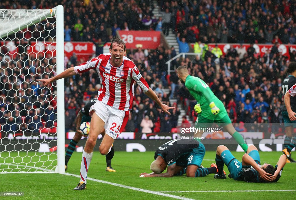 Peter Crouch of Stoke City celerbates scoring his side's second goal during the Premier League match between Stoke City and Southampton at Bet365 Stadium on September 30, 2017 in Stoke on Trent, England.