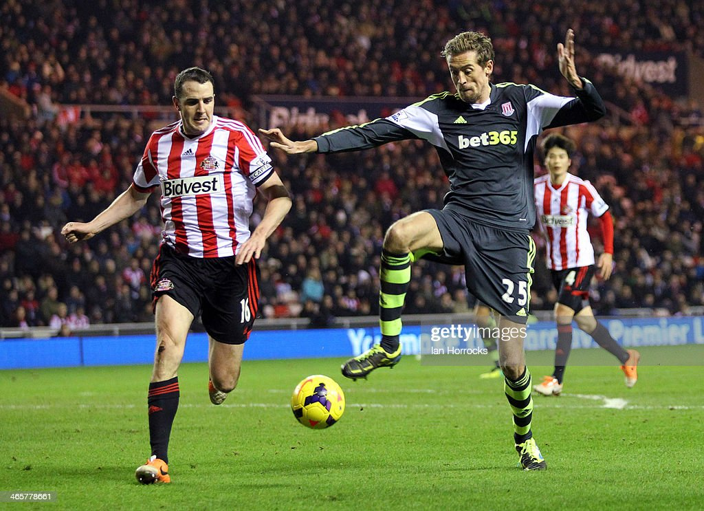 Peter Crouch of Stoke City (R) challenges John O'Shea of Sunderland (L)during the Barclays Premier League match between Sunderland and Stoke City at The Stadium of Light on January 29, 2014 in Sunderland, England.