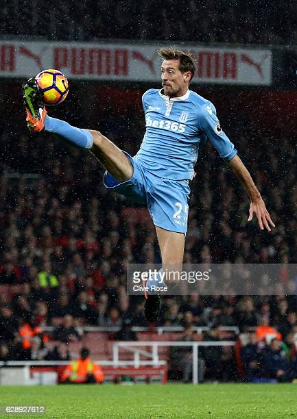 Peter Crouch of Stoke City controls the ball in mid air during the Premier League match between Arsenal and Stoke City at the Emirates Stadium on...