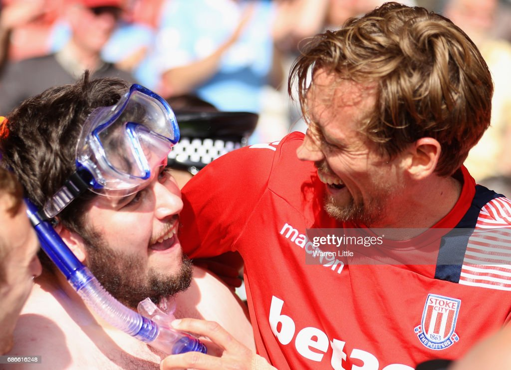 Peter Crouch of Stoke City hands over his shirt to the fan he chatted on Twitter pictured after the Premier League match between Southampton and Stoke City at St Mary's Stadium on May 21, 2017 in Southampton, England. The deal was if the fan came to the match wearing only a speedo swim suit Peter Crouch would give him his shirt after the match.
