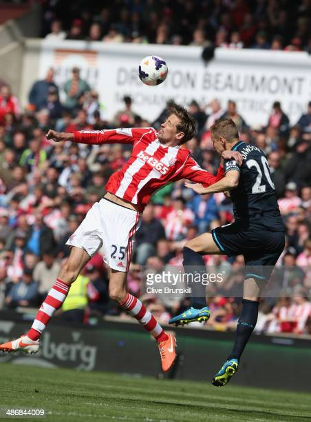 Peter Crouch of Stoke City in action with Michael Dawson of Tottenham Hotspur during the Barclays Premier League match between Stoke City and...