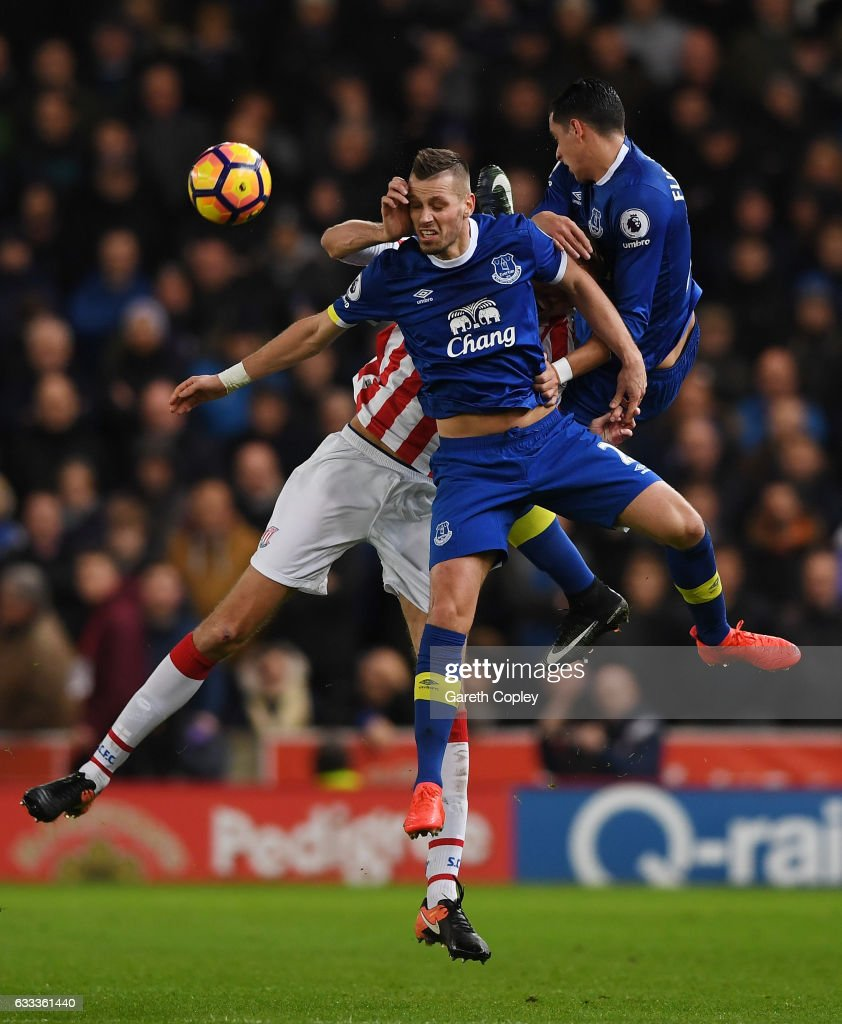 Peter Crouch of Stoke City is challenged by Morgan Schneiderlin and Ramiro Funes Mori of Everton during the Premier League match between Stoke City and Everton at Bet365 Stadium on February 1, 2017 in Stoke on Trent, England.