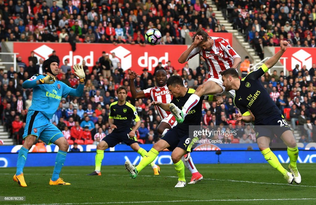 Peter Crouch of Stoke City scores his sides first goal past Petr Cech of Arsenal during the Premier League match between Stoke City and Arsenal at Bet365 Stadium on May 13, 2017 in Stoke on Trent, England.