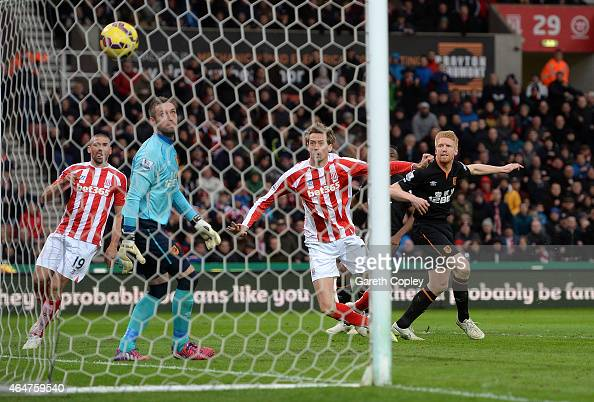 Peter Crouch of Stoke City scores the first goal during the Barclays Premier League match between Stoke City and Hull City at Britannia Stadium on...