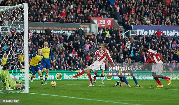 Peter Crouch of Stoke City scores the opening goal during the Barclays Premier League match between Stoke City and Arsenal at the Britannia Stadium...
