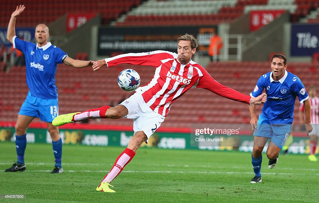 Peter Crouch of Stoke City shoots at goal during the Capital One Cup Second Round match between Stoke City and Portsmouth at Britannia Stadium on August 27, 2014 in Stoke on Trent, England.