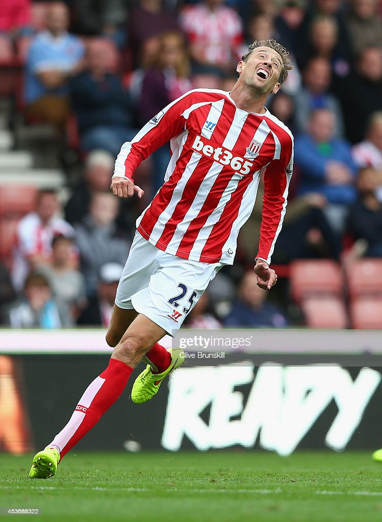 <a gi-track='captionPersonalityLinkClicked' href=/galleries/search?phrase=Peter+Crouch&family=editorial&specificpeople=210764 ng-click='$event.stopPropagation()'>Peter Crouch</a> of Stoke City shows his dejection during the Barclays Premier League match between Stoke City and Aston Villa at Britannia Stadium on August 16, 2014 in Stoke on Trent, England.