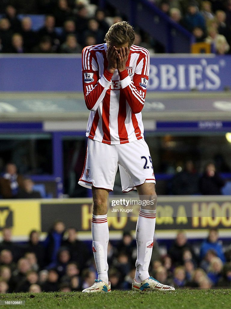 <a gi-track='captionPersonalityLinkClicked' href=/galleries/search?phrase=Peter+Crouch&family=editorial&specificpeople=210764 ng-click='$event.stopPropagation()'>Peter Crouch</a> of Stoke City shows his disappointment during the Barclays Premier League match between Everton and Stoke City at Goodison Park on March 30, 2013 in Liverpool, England.