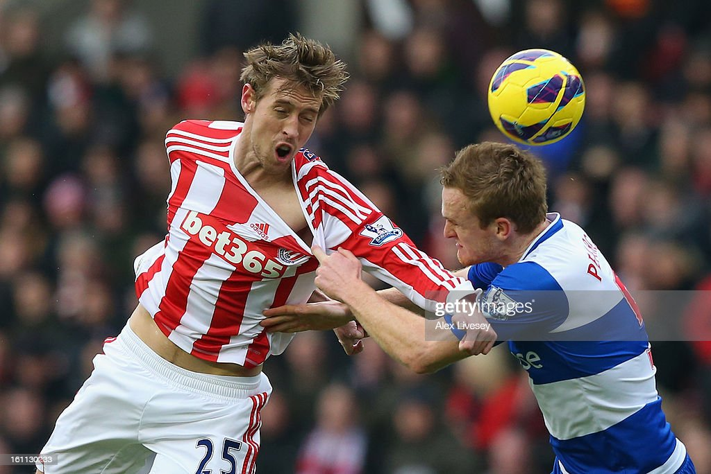 <a gi-track='captionPersonalityLinkClicked' href=/galleries/search?phrase=Peter+Crouch&family=editorial&specificpeople=210764 ng-click='$event.stopPropagation()'>Peter Crouch</a> of Stoke City tangles with Alex Pearce of Reading during the Barclays Premier League match between Stoke City and Reading at the Britannia Stadium on February 9, 2013, in Stoke-on-Trent, England.