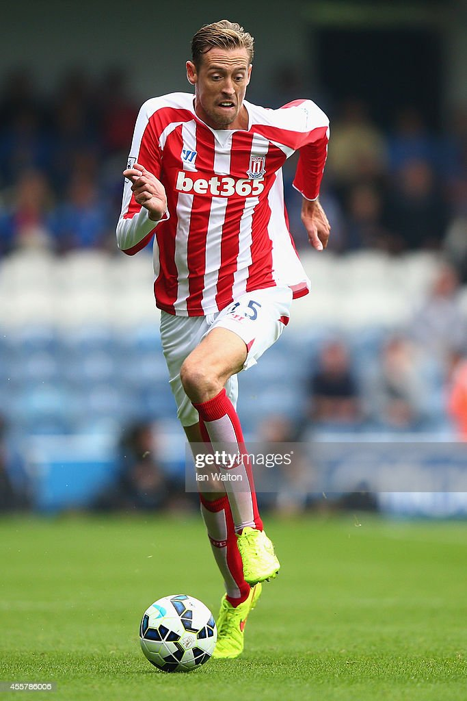 Peter crouch of stoke runs with the ball during the barclays premier picture id455786006
