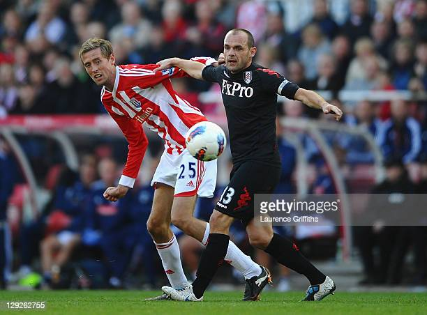 Peter Crouch of Stokebattles with Danny Murphy of Fulham during the Barclays Premier League match between Stoke City and Fulham at Britannia Stadium...