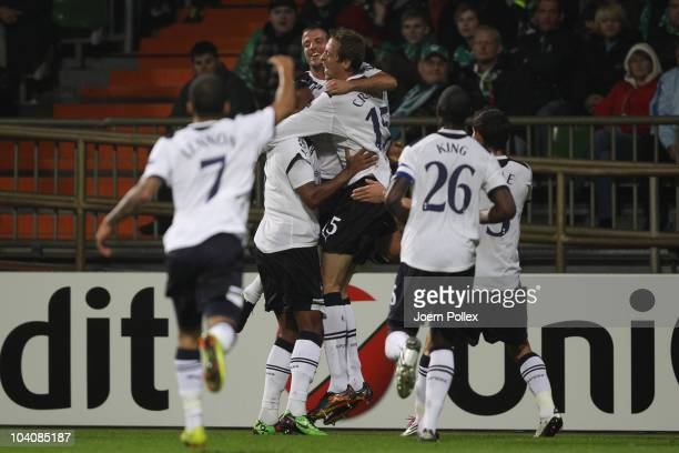 Peter Crouch of Tottenham celebrates with his team mates after scoring his team's second goal during the UEFA Champions League group A match between...