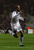 Peter Crouch of Tottenham Hotspur celebrates as he scores their first goal during the UEFA Champions League playoff second leg match between...
